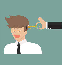 Man holding a key unlocking businessman mind vector