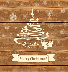 Christmas tree on a wooden boards vector image