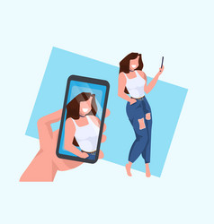 casual woman taking selfie on smartphone camera vector image