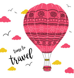 Hot air balloon with ornaments in cloudy sky vector