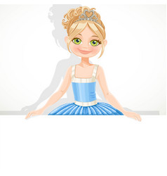 Beautiful blond ballerina girl in tiara and blue vector