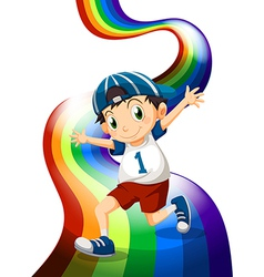 A boy and a rainbow vector image vector image