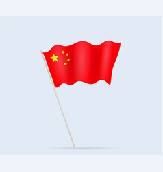 china flag on flagpole waving in wind vector image