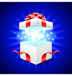 Opened gift box on blue background vector image