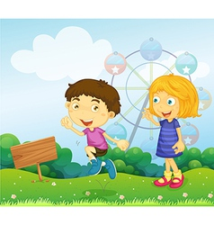 A boy and a girl playing near an empty signboard vector image vector image