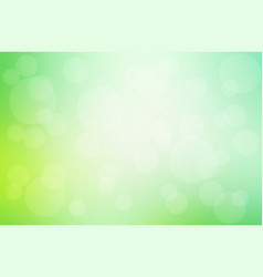 green yellow blurred background with bokeh lights vector image