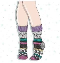 Woman wearing a pair of wool socks vector