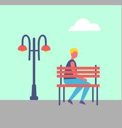 boy sitting alone on bench park near street lamp vector image