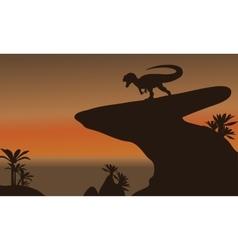 Silhouette of one allosaurus in cliff vector