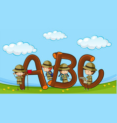 Font abc with kids in boyscout uniform vector