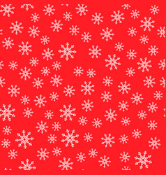seamless pattern white snowflakes on a red vector image