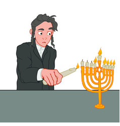 Little jewish boy lights the candles on chanukiah vector