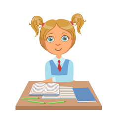 little schoolgirl sitting at the desk with vector image