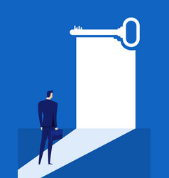 businessman looks at the key door of success vector image