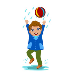 Boy playing with the ball kid in autumn clothes vector