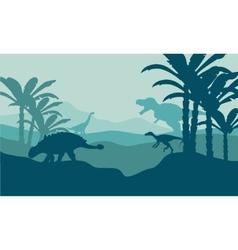 Silhouette of eoraptor and ankylosaurus vector