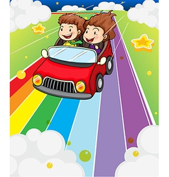 Two kids riding in a red car vector