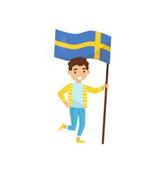 boy holding national flag of sweden design vector image