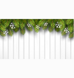 Christmas wooden background with fir branches vector image