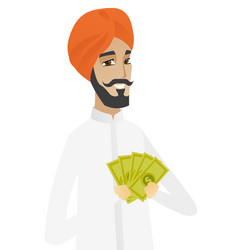 happy hindu businessman holding money vector image