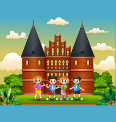 cartoon of happy school children standing in front vector image