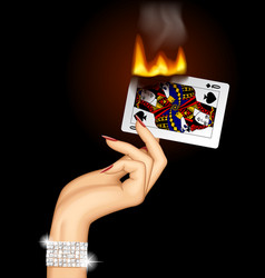 Hand with a burning playing card vector