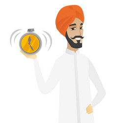 Hindu businessman holding alarm clock vector