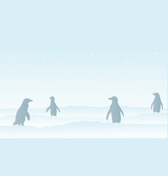 Silhouette penguin on snow scenery vector