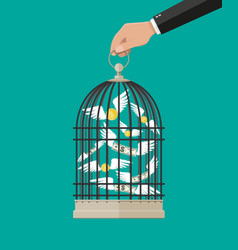 hand holds cage with flying money vector image
