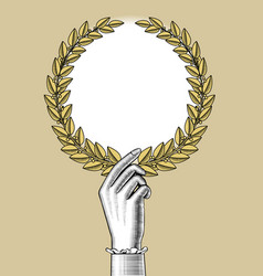 womans hand holding a laurel wreath vector image