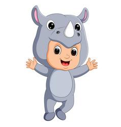 cute boy cartoon wearing rhinoceros costume vector image