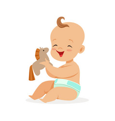 Adorable happy baby in a diaper sitting and vector