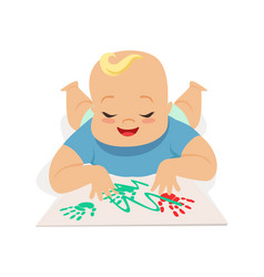 cute happy baby boy painting by hands colorful vector image