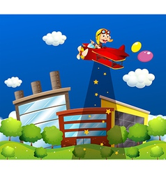 A monkey riding in an aircraft above the buildings vector image