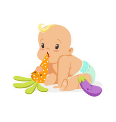 Adorable baby in a diaper sitting and playing with vector