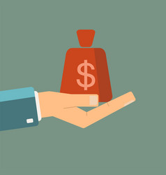 Hand holding money bag vector