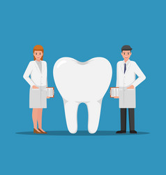 male and female dentist standing with big tooth vector image