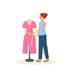 Seamstress standing near mannequin in red dress vector