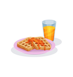 Belgian waffles with caramel topping and glass of vector