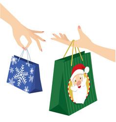 woman hand holding christmas shopping bag vector image vector image