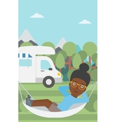 Woman lying in hammock in front of motor home vector
