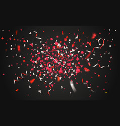 colorful confetti and ribbons on dark background vector image