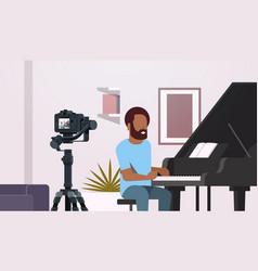 Guy musical blogger recording video on camera vector