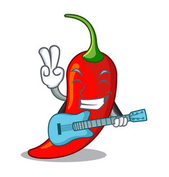 With guitar hot chili pepper on cartoon table vector