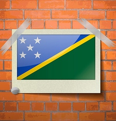 Flags Solomon Islands scotch taped to a red brick vector image