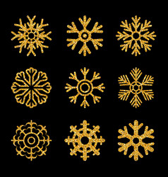set gold sparkling snowflakes vector image