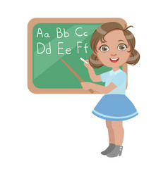 Cute little girl standing near the blackboard and vector