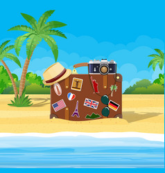 Vintage old travel suitcase on beach vector