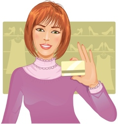 Young woman with a credit card vector image