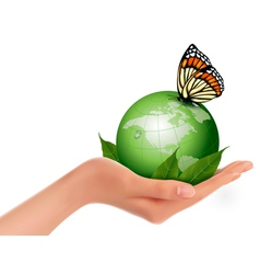 Green world with leaf and butterfly in woman hand vector image vector image